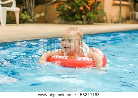 Toddler Boy Swims In The Pool