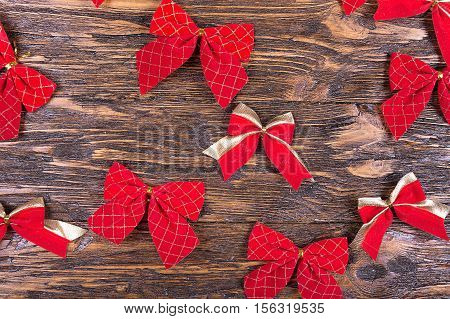 many red Christmas bows on a wooden table Christmas tree decoration Christmas mood