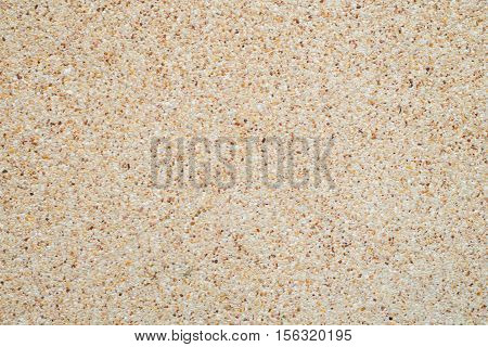 Little pebbles on cement wall and ground Rough sand stone texture background