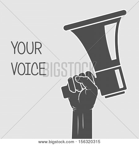 Hand holding megaphone - voice and opinion concept