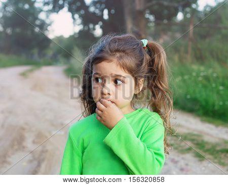 Sad cute little girl looking sad and afraid