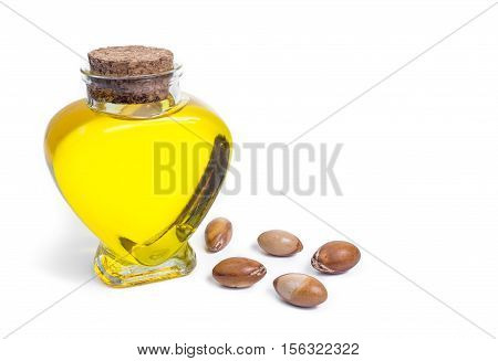 Argan oil. Bottle with oil. Cosmetic means. Food product. Jar with argan oil on the isolated background.