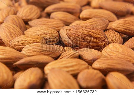 Almonds background. Pile of selected almonds close-up. For vegetarians.