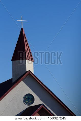 Architectural detail of steeple and cross of Christian church
