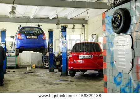 Moscow, Russia - November, 2, 2016: Cars under repair in a car repair station in Moscow, Russia