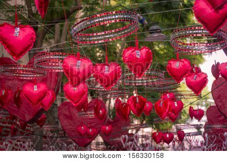 Red hearts hanging and moving in neighbourhood festival of Gracia district in Barcelona. Suitable for Valentine's Day or Love ideas.