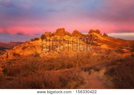 Pink clouds over the Devil's backbone open space in Loveland Colorado. This is a popular local hiking and biking area in Larimer County