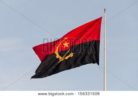 Flag of Angola flying at the Sao Miguel Fortress Luanda. It is supposed to be one of the tallest flags in Africa.