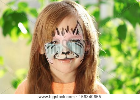 Portrait of cute girl with aqua makeup