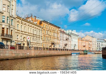 ST PETERSBURG RUSSIA-OCTOBER 3 2016. Historic buldings and embankment of Moika river in sunny day in St Petersburg Russia. Saint Petersburg is the most Westernized city of Russia