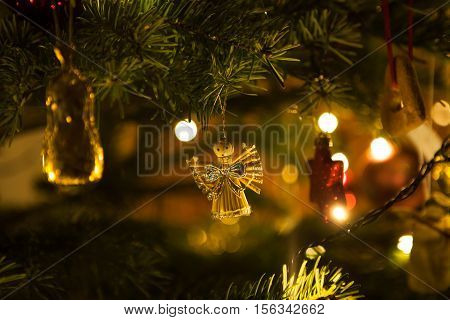 Christmas angel hanging on a christmas tree branch