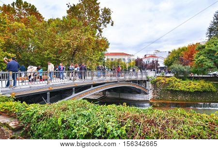 TRIKALA GREECE, OCTOBER 28 2016: tourists celebrating the national greek holiday of 28th October at the bridge of Lithaios river Trikala Greece. Editorial use.
