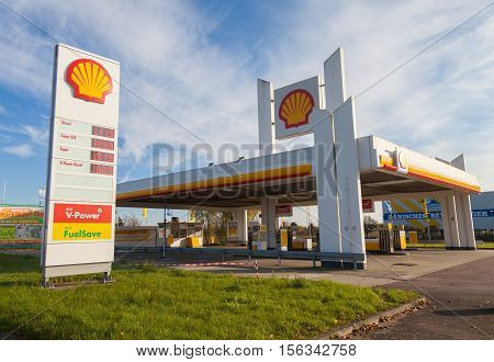 BURG / GERMANY - NOVEMBER 13 2016: Shell gas station sign. Shell is an Anglo-Dutch multinational oil and gas company headquartered in the Netherlands and incorporated in the United Kingdom.