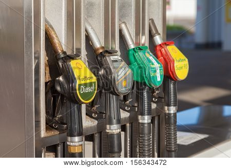 BURG / GERMANY - NOVEMBER 13 2016: Filling nozzles at a Shell gas station. Shell is an Anglo-Dutch multinational oil and gas company headquartered in the Netherlands.