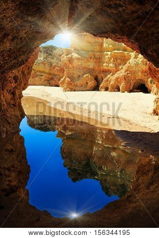 Rocky Arch And Sunshine On Algarve Beach