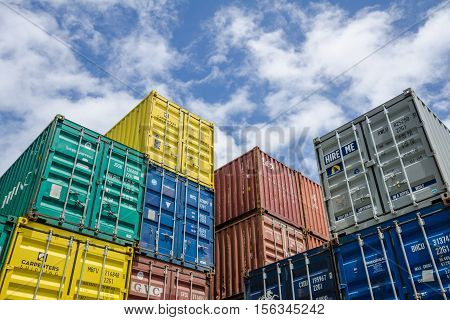 PORT VILA - VANUATU OCTOBER 27, 2016: Colorful shipping containers are stacked up in the port of the capital city of the archipelago of 82 volcanic islands in the South Pacific Ocean.