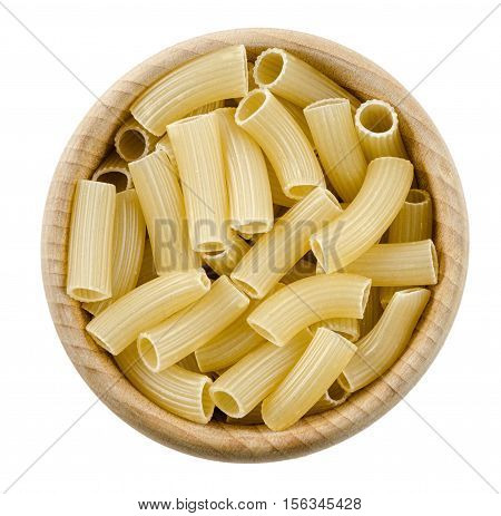 Penne rigate pasta in wooden bowl. Uncooked dried durum wheat semolina pasta. Isolated on white background