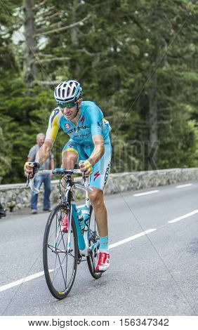 Col du Tourmalet France - July 242014: The Italian cyclist Alessandro Vanotti of Astana Team climbing the difficult road to Col du Tourmalet in Pyrenees Mountains during the stage 18 of Le Tour de France 2014.