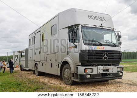 Tyumen, Russia - June 25, 2016: The 5th open championship of Russia on a plowed land. Special built trailer for transporting animals such as camels and horses