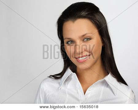 beautiful woman smiling behind a white background