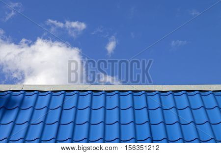 Blue metal roof against the blue sky.