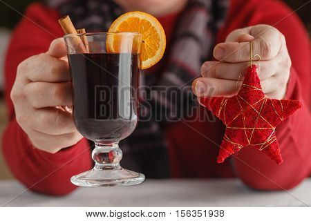 Mulled Wine With Addition Of An Orange, Honey, Cinnamon, A Carnation And An Anise, Man's Hands Hold
