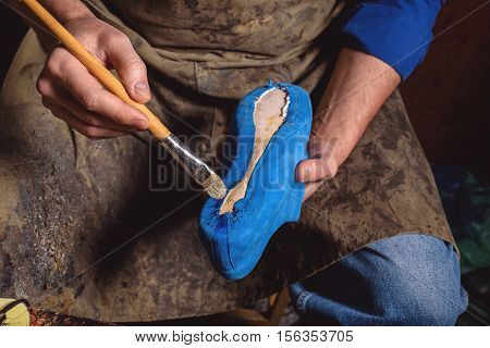 skin affixing to the sole of the shoe by a master, close up