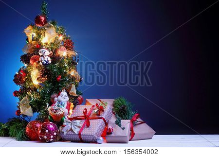 Christmas Greetings Card.blue Background.christmas Tree With Gifts On Blue Background.