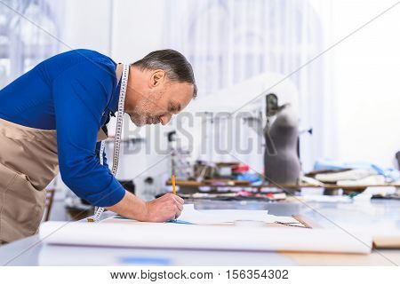 businessman working with a plan at the desk indoors