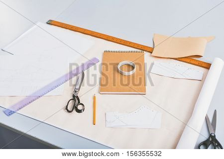 equipment of a tailor and designer on a table, creative concept