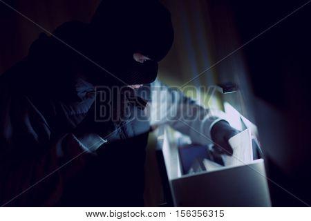 burglary  man stealing documents