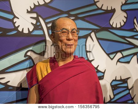 London, the UK - May 2016:  Dalai Lama wax figure in Madame Tussaud museum