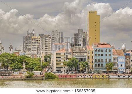 RECIFE, BRAZIL, JANUARY - 2016 - Cityscape view of eclectic style buildings at riverfront in Recife city Brazil