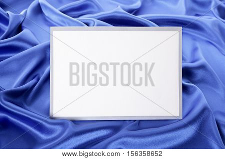 Blank Greetings Card Or Invitation With Blue Satin Background.