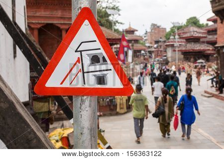 Kathmandu, Nepal - May 24, 2016: Road sign about construction after earthquake on Durbar square in Kathmandu, Nepal