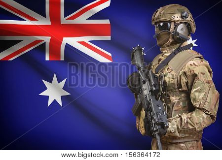 Soldier In Helmet Holding Machine Gun With Flag On Background Series - Australia