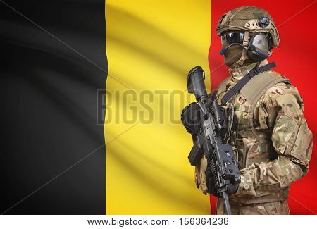 Soldier In Helmet Holding Machine Gun With Flag On Background Series - Belgium