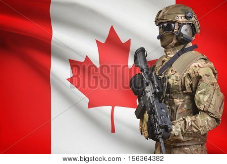 Soldier In Helmet Holding Machine Gun With Flag On Background Series - Canada