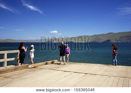 BAIKAL LAKE, OLKHON ISLAND, RUSSIA - 7 JULY, 2016: Tourists at Baikal Lake, Olkhon Island, Siberia, Russian Federation