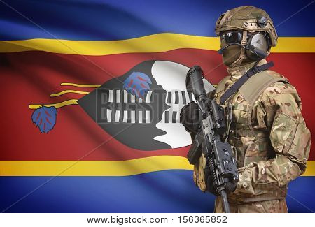 Soldier In Helmet Holding Machine Gun With Flag On Background Series - Swaziland