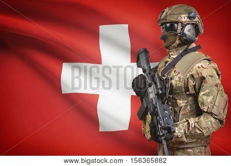Soldier In Helmet Holding Machine Gun With Flag On Background Series - Switzerland