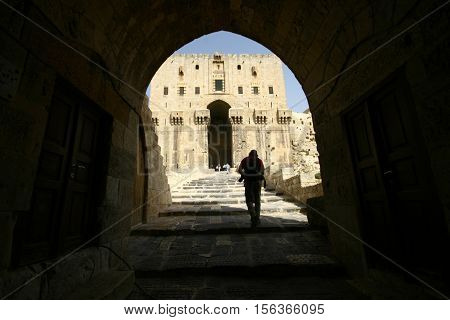 ALEPPO, SYRIA-OCTOBER 12 :Unidentified people in the Citadel of Aleppo. Medieval fortified palace in the old city of Aleppo in Syria on October 12, 2007. UNESCO World Heritage Site since 1986.