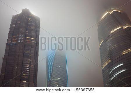 SHANGHAI, CHINA - NOV 7, 2015: Shanghai tower, Shanghai Jinmao Hotel and Shanghai World Financial Center at night, Shanghai - financial and commercial center of China
