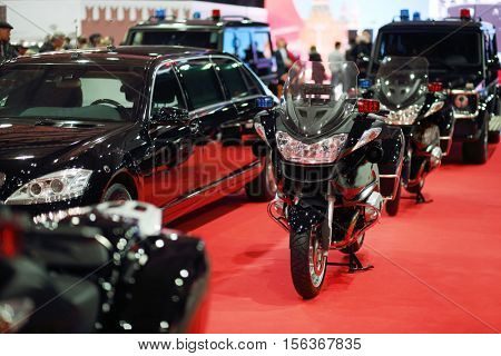 MOSCOW - MAR 07, 2016: Car, bikes of cortege with blinkers at exhibition Oldtimer-Gallery in Sokolniki Exhibition Center. It is only one in Russia exhibition of vintage cars and technical antiques