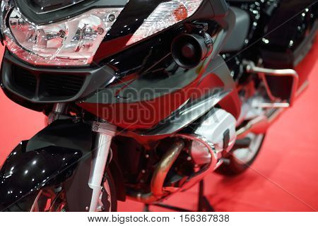 MOSCOW - MAR 07, 2016: Black modern bike at exhibition Oldtimer-Gallery in Sokolniki Exhibition Center. It is only one in Russia exhibition of vintage cars and technical antiques