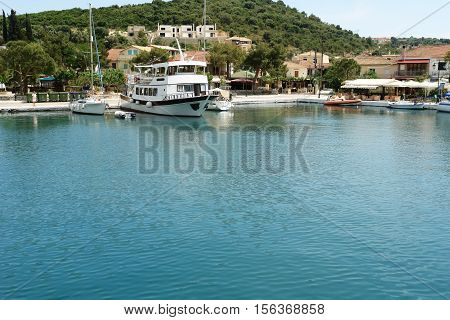 Vathi GREECE May 11 2013: Landscape with mooring and ferry-boat in port of Vathi on the Meganisi island. Ionian sea Greece.