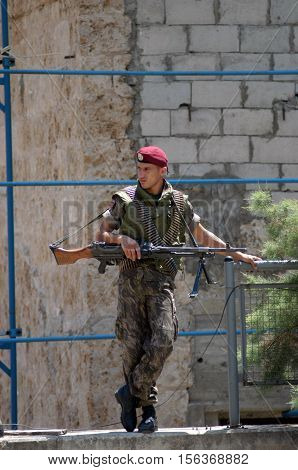 BEIRUT,LEBANON- AUGUST 5: Unidentified soldier stands guard in a check point in Beirut on August 5, 2006.