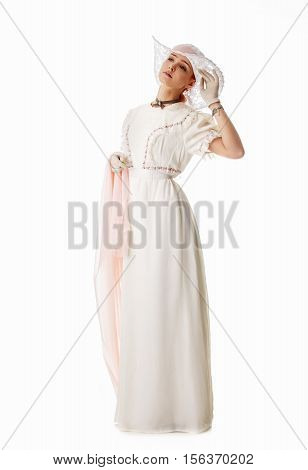 Woman in white dress and big white hat. Retro dress historical costume. Isolated on white.