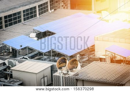 Solar cell panel on the rooftop of office or factory building with sunlight effect filter. Solar energy concept.
