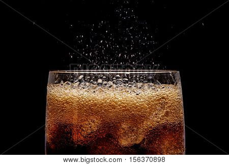 Ice Cola With Splashing Co Bubbles.